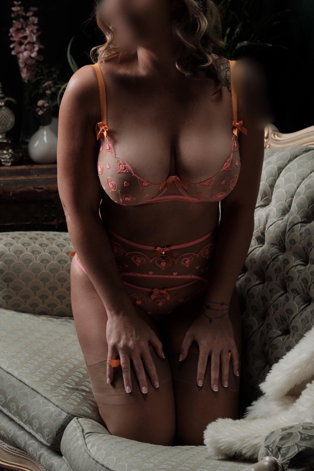 Rachel Sweets Toronto escort posing on bed